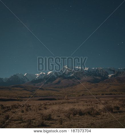 Beautiful autumn landscape with mountains covered with snow, Altai region, Siberia, Russia