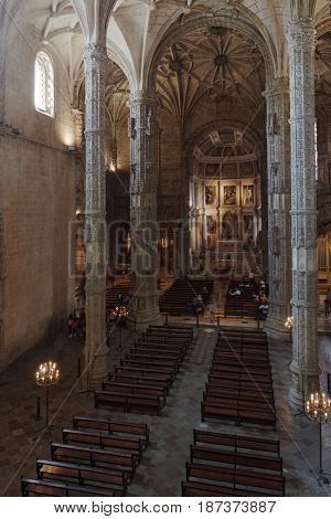 LISBON, PORTUGAL - MAY 11, 2017: Tourists in the Church of Santa Maria of Jeronimos Monastery. Since 1983, the monastery is listed as UNESCO World Heritage site