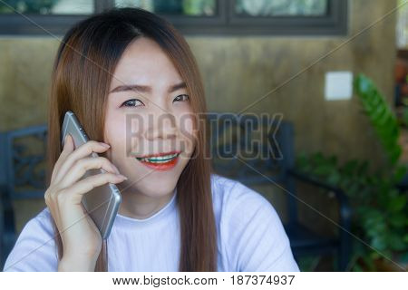 Asia girl use smart phone emotion happy and smile in cafe.