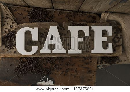 Letters Spelling Cafe On Rustic Wooden Surface