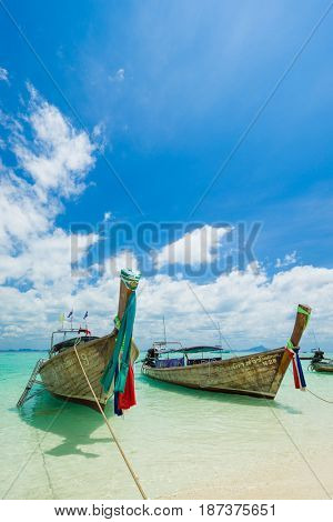 PHI PHI ISLAND, THAILAND - FEBRUARY 24: Longtail boat taxi on the Long Beach on February 24 2017  in Phi Phi island, Thailand.