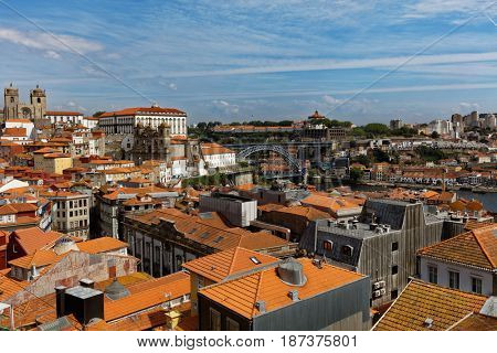 PORTO, PORTUGAL - MAY 8, 2017: Cityscape of historical district Ribeira and Dom Luis I bridge. Since 1996, the historical center of Porto is listed as UNESCO World Heritage site