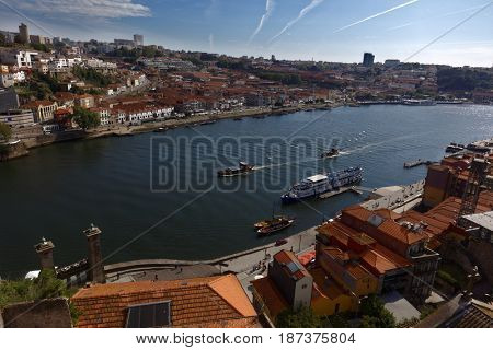 PORTO, PORTUGAL - MAY 8, 2017: Boats on Douro river in a spring day. Duero is one of the major rivers of the Iberian Peninsula