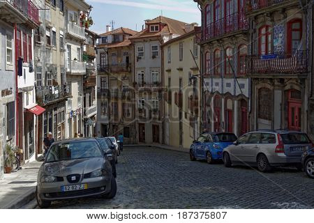 PORTO, PORTUGAL - MAY 8, 2017: Rua das Taipas street in historical district Ribeira. Since 1996, the historical center of Porto is listed as UNESCO World Heritage site
