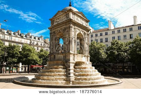 The Fontaine des Innocents is a monumental public fountain located on the place Joachim-du-Bellay in the Les Halles district in the 1st arrondissement of Paris, France.