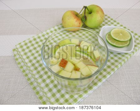 Detox water with apple and lemon in drinking glass