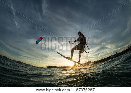 Kite surf ride his hydrofoilkite