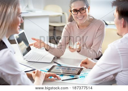 Business people working with tablet computer in an office. Close-up