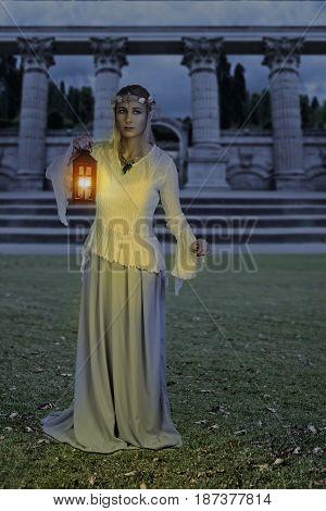 female high elf with lantern at night