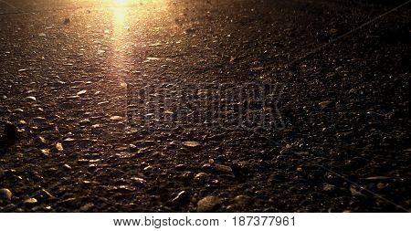 Asphalt, asphalt background, asphalt texture. Grunge background. Brown, brown background.