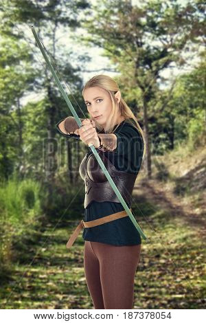 female wood elf shooting a bow on forest path