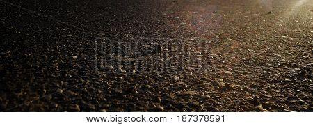 Asphalt, asphalt background, asphalt texture. Grunge, grunge background. Brown, brown background.