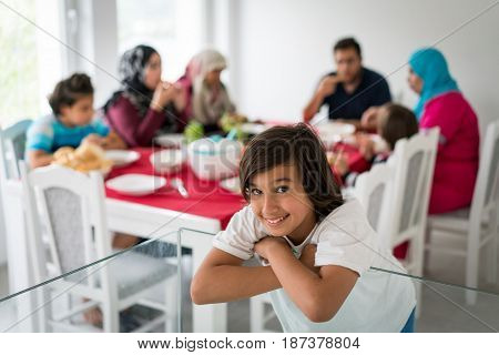 Happy muslim family enjoying togetherness at dining table