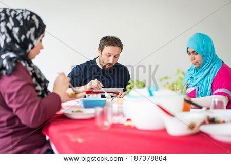 Happy muslim family enjoying iftar in ramadan