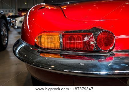 STUTTGART GERMANY - MARCH 04 2017: Rear stoplights of sports car Jaguar E-Type 1962. Europe's greatest classic car exhibition