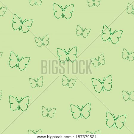Seamless pattern of butterflies on a green background. Vector picture of moths