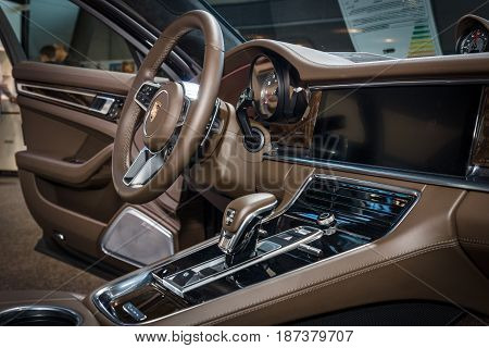 STUTTGART GERMANY - MARCH 04 2017: Interior of the full-size luxury car Porsche Panamera Turbo 2016. Europe's greatest classic car exhibition