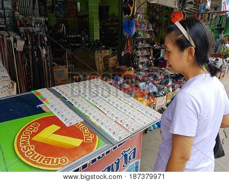 CHIANG RAI THAILAND - MAY 6 : unidentified woman choosing a lottery ticket in a market on May 6 2017 in Chiang rai Thailand.