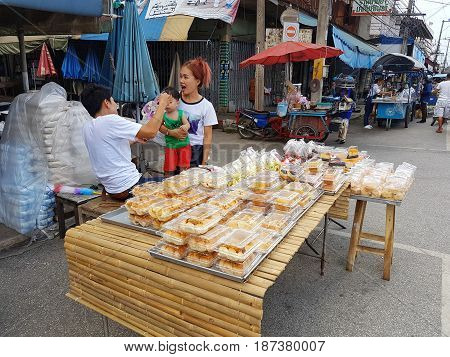 KAMPHAENG PHET THAILAND - MAY 6 : unidentified asian people selling bakery products in Nakhon Chum street market on May 6 2017 in Kamphaeng Phet Thailand.