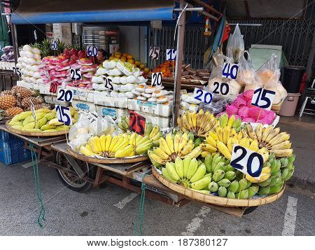KAMPHAENG PHET THAILAND - MAY 6 : unidentified asian people selling fruits in Nakhon Chum street market on May 6 2017 in Kamphaeng Phet Thailand.