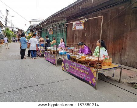 KAMPHAENG PHET THAILAND - MAY 6 : unidentified asian woman with Thai traditional clothing selling food in Nakhon Chum street market on May 6 2017 in Kamphaeng Phet Thailand.