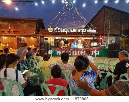 KAMPHAENG PHET THAILAND - MAY 6 : unidentified people watching show on stage in Nakhon Chum street market on May 6 2017 in Kamphaeng Phet Thailand.