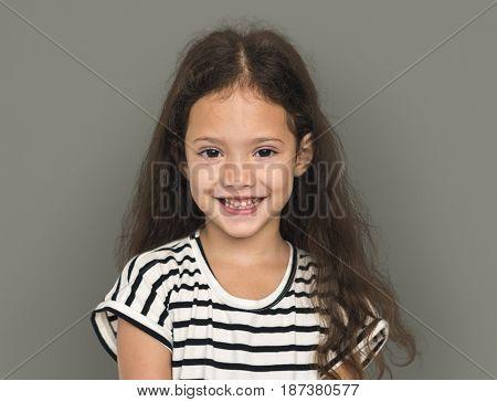 Little girl smiling casual studio portrait