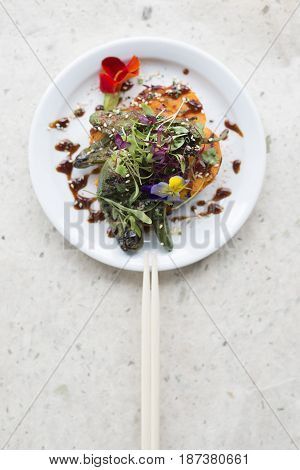 Overhead Of Chopsticks On Plate Of Vegetable Salad Meal