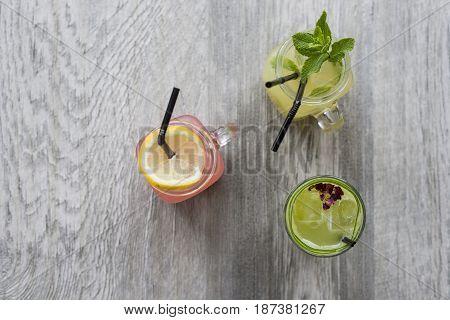 Overhead Shot Of Natural Fruit Drinks In Masonry Jars