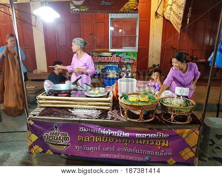 KAMPHAENG PHET THAILAND - MAY 6 : unidentified asian women with Thai traditional clothing selling food in Nakhon Chum street market on May 6 2017 in Kamphaeng Phet Thailand.