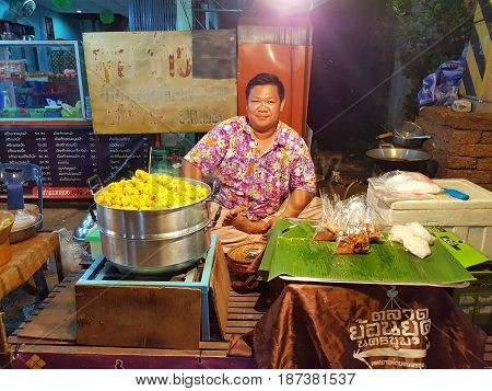 KAMPHAENG PHET THAILAND - MAY 6 : unidentified asian man with Thai traditional clothing selling dim sim in Nakhon Chum street market on May 6 2017 in Kamphaeng Phet Thailand.