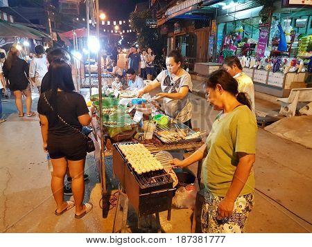 KAMPHAENG PHET THAILAND - MAY 6 : unidentified asian people walking in Nakhon Chum street market on May 6 2017 in Kamphaeng Phet Thailand.