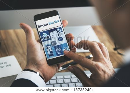 Hands working on digital device network graphic overlay