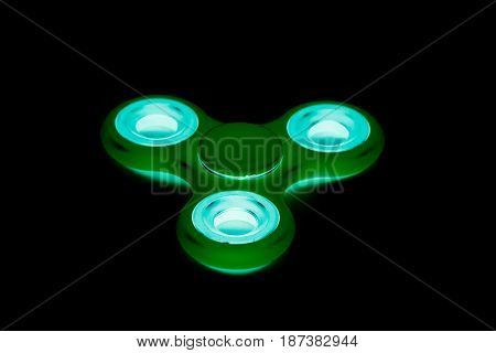 Fidget Spinner in black isolated background for stress release during work
