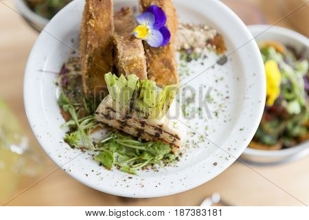 Overhead Shot Of Grilled Turnip With Fried Tofu On Plate