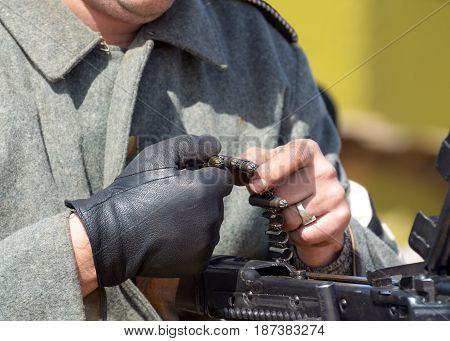 German soldiers charging a machine gun with live ammunition.