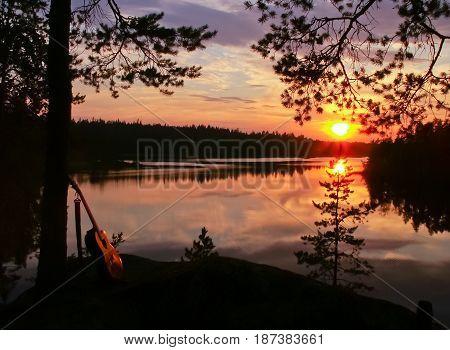 Sunset over Berezovskoye forest lake, summer, Karelia