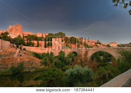 Medieval Toledo seen at sunset from the surrounding river Tajo (which means cut)