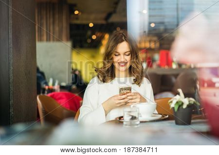 Beautiful, woman chatting with her phone
