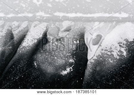 Ice texture of a frozen river in winter