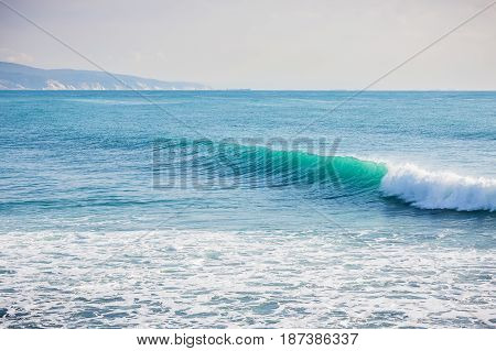 Blue wave in ocean and Sunny day