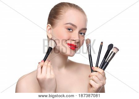 Beauty, cosmetics, professional makeup background. Woman with brush set isolated on white