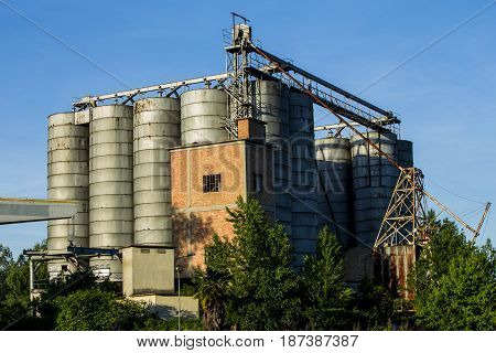 Silos, factory on blu sky in background.