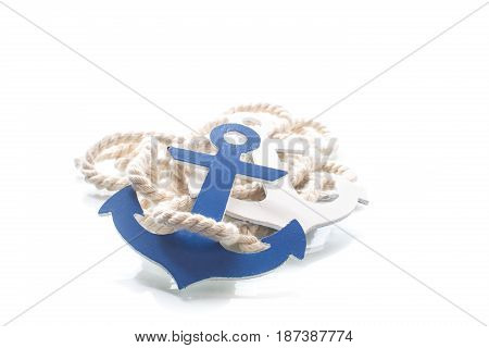 Wooden decorative anchor on the white background