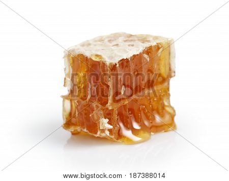 small piece of honeycomb isolated on white background