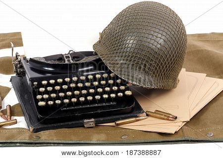 the US military helmet of the Second World War with old typewriter