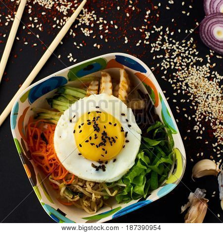 Bibimbap. Traditional korean cuisine. Mixed rice with meat and assorted vegetables.