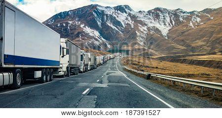 Beautiful mountain military road in Georgia with truks queue