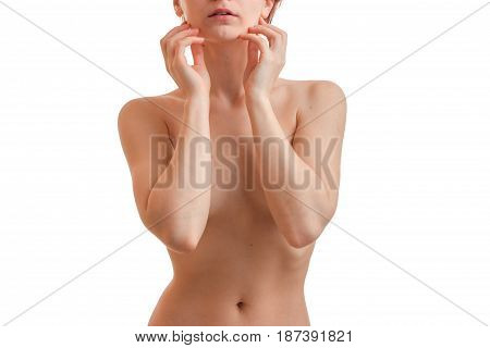naked young girl stands right in front of the camera and covered her hands her breasts close-up isolated on white background