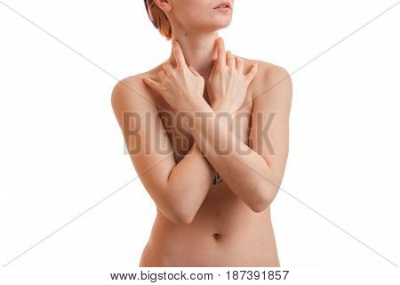 tender young naked girl looks away and folded her hands on my chest close-up isolated on white background